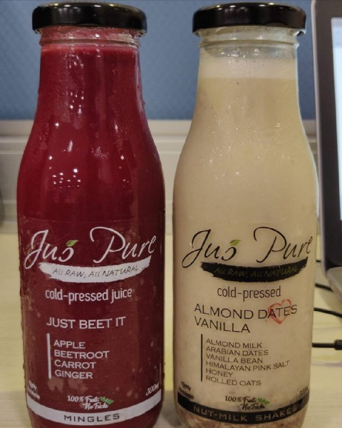 Photo shared by Chennai Foodgasm on June 19, 2021 tagging @jus.pure. May be an image of drink, indoor and text that says 'Juš All RAW; All NATURAL Pure JuÅ Purt cold-pressed juice cold-pressed ALMOND DATES VANILLA ALMOND ARABIAN MILK HONEY HIMALAYNKSALT ROLLED OATS JUST BEET IT APPLE BEETROOT CARROT GINGER 100% 100%Full; Tricks MINGLES 100%'.