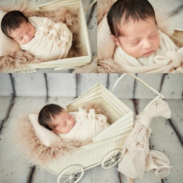 Photo by Baby Studio on July 30, 2021. May be an image of 3 people and baby.