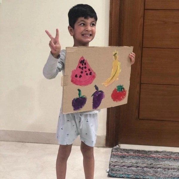Photo by Pratha Pre School on July 28, 2021. May be an image of 1 person, child, standing, fruit and indoor.