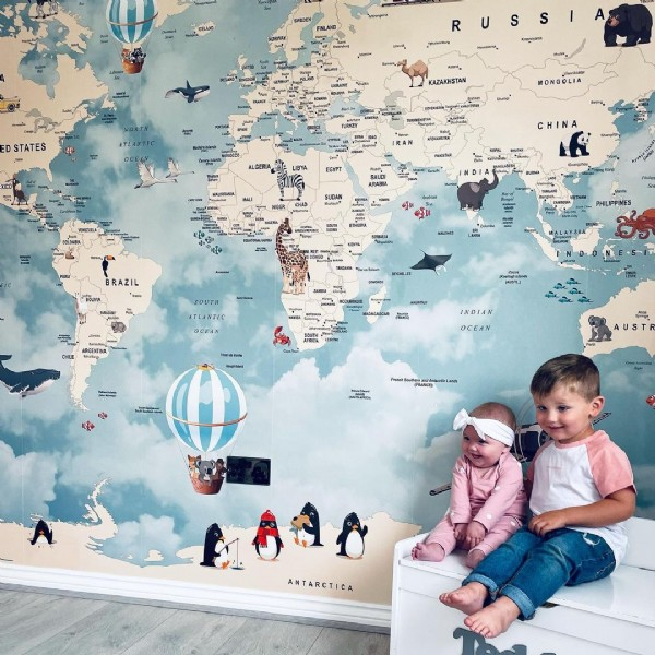 Photo shared by   & ℕ  on August 01, 2021 tagging @photowall_sweden, @mutualmamas, and @mumssupportfamily. May be an image of 2 people, child, people standing, map and indoor.