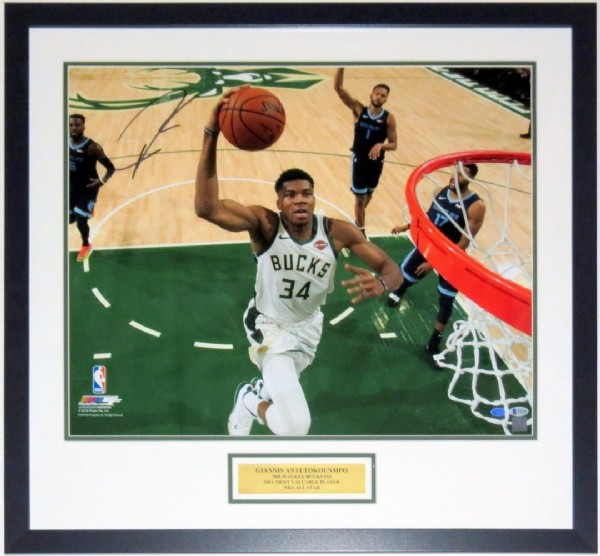 Photo by Bleachers Sports and Framing in Bleachers Sports and Framing with @bucks, @nba, @giannis_an34, @beckettmediallc, and @fiservforum. May be an image of 2 people, people playing sports and ball.