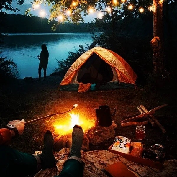 Photo by Aishwarya Panchal on July 26, 2021. May be an image of sitting, campsite, fire and outdoors.