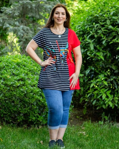 Photo by Moda Queen Boutique on August 01, 2021. May be an image of 1 person, standing, stripes and outdoors.