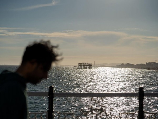 Photo by Moon Hwan Lee / 이문환 in Brighton Pier. May be an image of one or more people, sky and ocean.