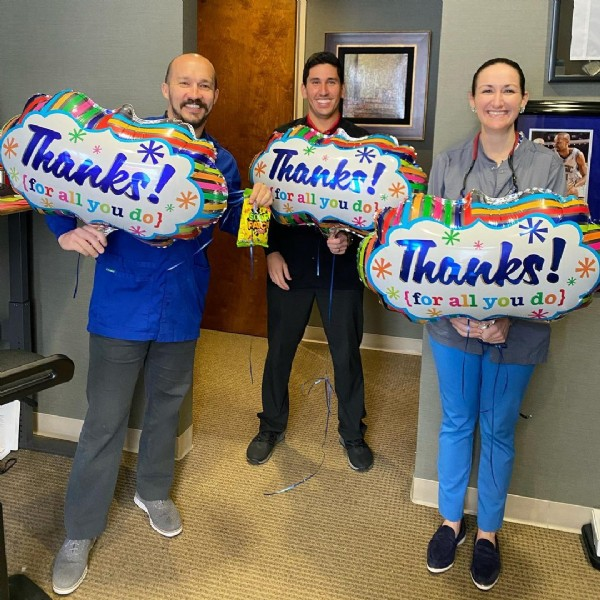 Photo by Lake Nona Dental Group in Lake Nona Dental Group, PLC. May be an image of 4 people and balloon.
