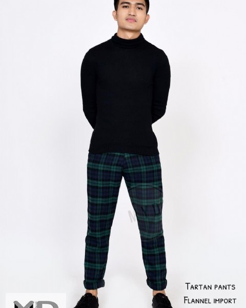 Photo by Nukea store on August 02, 2021. May be an image of 1 person, standing and text that says 'TARTAN PANTS FLANNEL IMPORT'.
