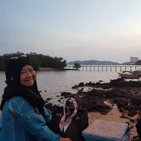 Photo by Naliza Fahro-Rozi in Teluk Pelanduk Port Dickson. May be an image of 1 person, sitting, twilight, ocean and sky.