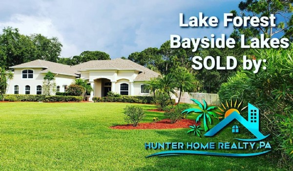Photo by Hunter Home Realty in Palm Bay, Florida. May be an image of grass, tree and text that says 'Lake Forest Bayside Lakes SOLD by HUNTER HOME REALTY ,PA'.