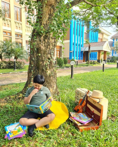 Photo by Anita Fitria on June 16, 2021. May be an image of 1 person, child, sitting, tree and outdoors.