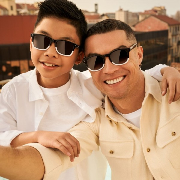 Photo by Cristiano Ronaldo on May 25, 2021. May be an image of 2 people, people sitting, people standing and sunglasses.