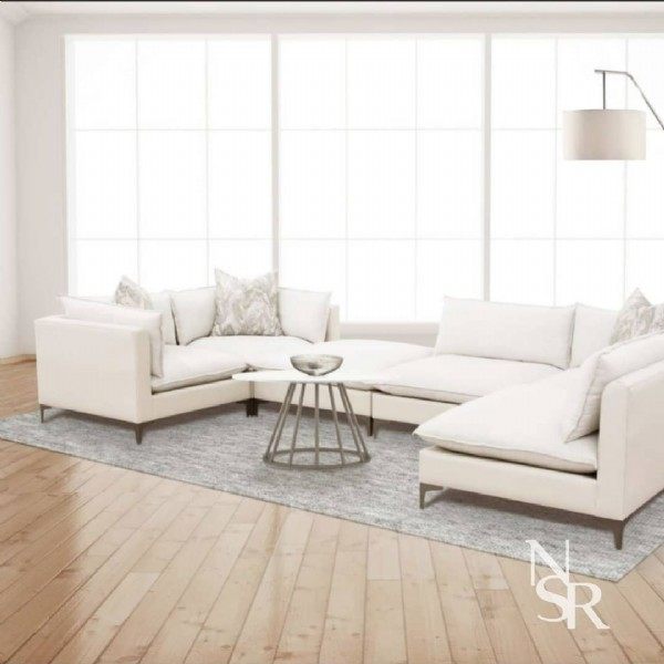 Photo by Nasser Muebles on June 18, 2021. May be an image of sofa, living room and text.
