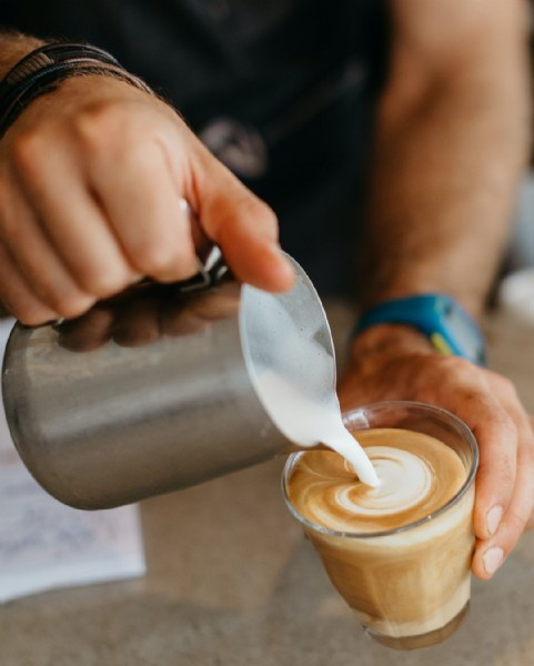 Photo by RE Collective in RE Collective. May be an image of one or more people, coffee, coffee cup and indoor.