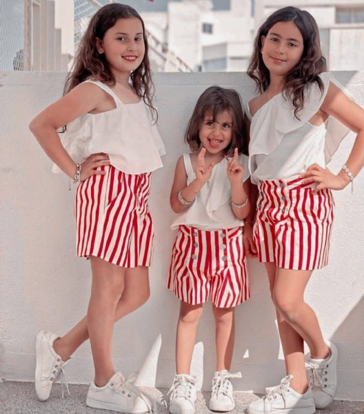 Photo shared by nyzsisters_fan on June 19, 2021 tagging @nyzsisters. May be an image of 3 people, child, people standing, footwear, shorts and stripes.