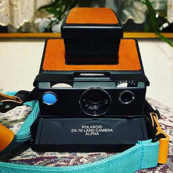 Photo by Meg on June 12, 2021. May be an image of camera and text that says 'POLAROID SX-70 LAND CAMERA ALPHA'.