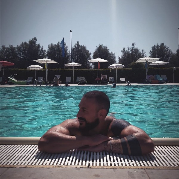 Photo by Luca Trapani on July 31, 2021. May be an image of 1 person, beard, standing and pool.
