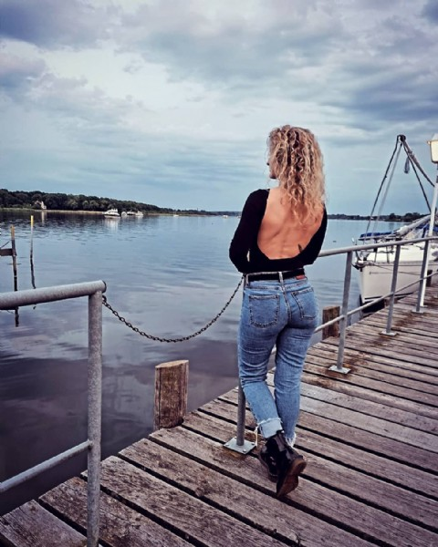 Photo by Ni Ma in Potsdam, Germany. May be an image of one or more people, people standing and lake.