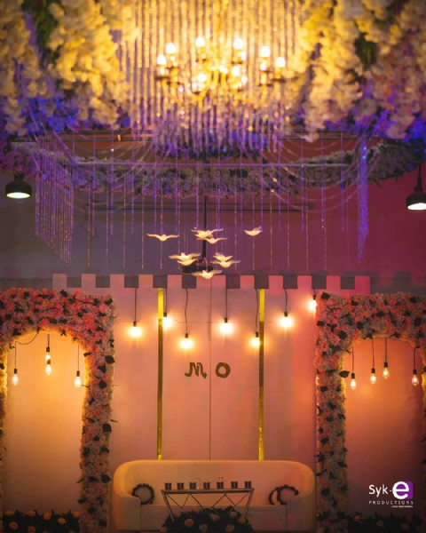 Photo by Kaduna Wedding & Event Decor in Epitome Hotel and Suites Ltd.. May be an image of chandelier, cake, flower and indoor.