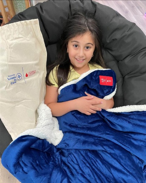 Photo shared by Subaru of America on June 18, 2021 tagging @llsusa. May be an image of 1 person, child, sitting and indoor.