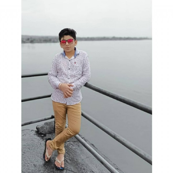 Photo by  साहिल  in आपलं गंगाखेड. May be an image of 1 person, standing, sunglasses, sky and lake.
