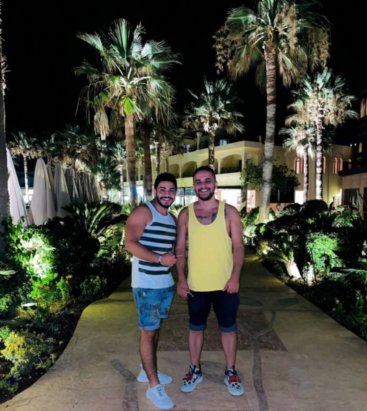 Photo shared by HAMADA YOUSEF on July 29, 2021 tagging @omar_baradie1. May be an image of 2 people, people standing, outdoors and palm trees.