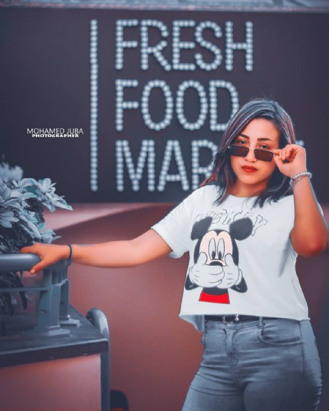 """Photo by شوشةً بلدكو"""" on July 30, 2021. May be an image of 1 person, sunglasses and text that says 'MOHJUBA PHOTOGRAPHER FRESH FOOD MAR'."""