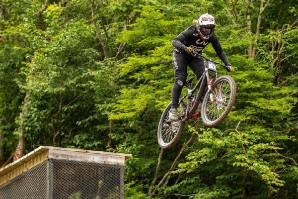 Photo shared by caroline washam on June 19, 2021 tagging @schwalbetires, @srammtb, @rockshox, @industry_nine, @livcyclingusa, @tld_bike, and @flattiredefend. May be an image of one or more people, people playing sports, bicycle and outdoors.