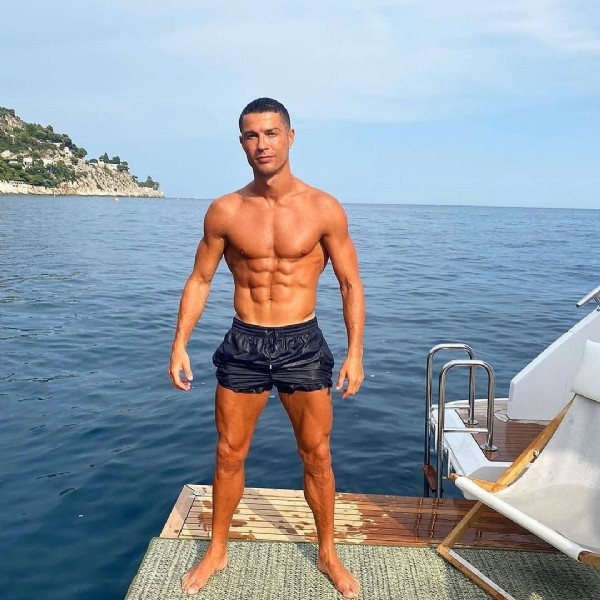 Photo by Cristiano Ronaldo on June 06, 2021. May be an image of 1 person, standing and ocean.