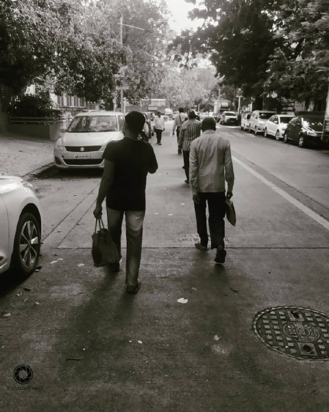 Photo by Vishal on June 09, 2021. May be a black-and-white image of one or more people, people standing, road and street.