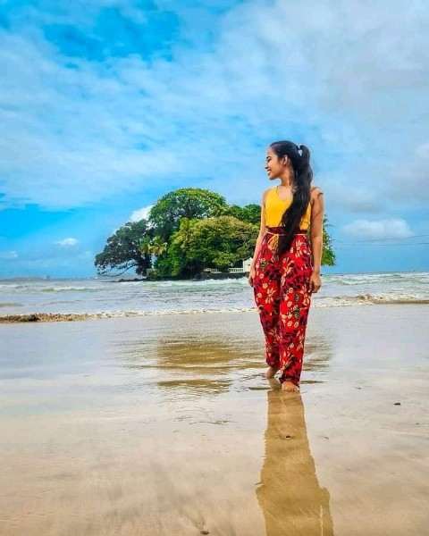 Photo by Traveling Siri Lanka in Sri Lanka. May be an image of 1 person, standing, ocean, sky, tree and beach.
