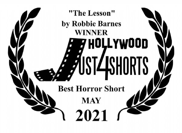 """Photo shared by One Eye Wilde on May 31, 2021 tagging @_robbiebarnes. May be an image of text that says '""""The Lesson"""" by Robbie Barnes WINNER HOLLYWOOD UST44SHORTS Best Horror Short MAY 2021'."""