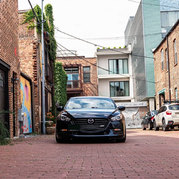 Photo shared by Siah's Original on July 31, 2021 tagging @mazdafitment, @3rdgenmazda, and @mazda_magazine. May be an image of car, road and brick wall.