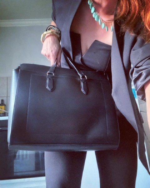 Photo by Stephanie Michelle on June 21, 2021. May be an image of purse and saddle-stitched leather.