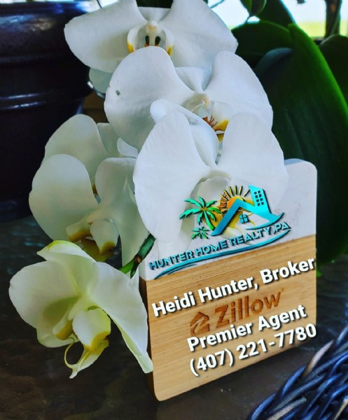 Photo by Hunter Home Realty in West Melbourne, Florida. May be an image of flower and text that says 'T P HOME HUNTER Broker Heidi Hunter, Zillow Agent Premier 221-7780 (407)'.