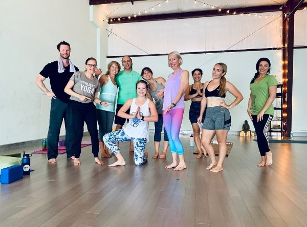 Photo shared by Sunlight Yoga on April 19, 2021 tagging @elizabethconstant. May be an image of 10 people, people standing and indoor.