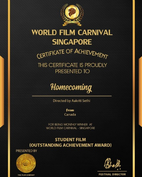 Photo by Aakriti on May 29, 2021. May be an image of text that says '2 orldFilmCariyal WORLD FILM CARNIVAL SINGAPORE CERTIFICATE OF ACHIEVEMENT THIS CERTIFICATE IS PROUDLY PRESENTED TO Homecoming Directed by Aakriti Sethi from Canada FOR BEING MONTHLY WINNER AT WORLD FILM CARNIVAL SINGAPORE STUDENT FILM (OUTSTANDING ACHIEVEMENT AWARD) PRESENTED BY ILMCMPY Bhal FVA FESTIVAL DIRECTOR'.