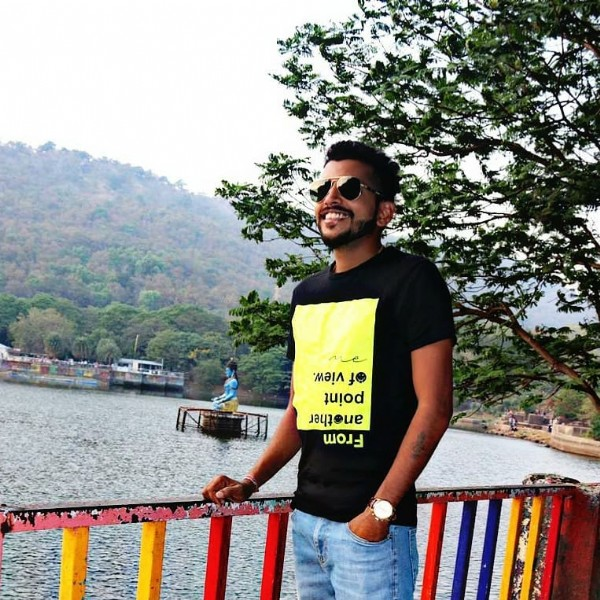 Photo by Ganesh Gudekar on May 31, 2021. May be an image of 1 person, standing, sunglasses, sky, lake and tree.