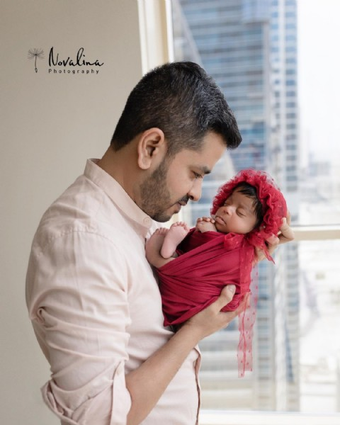Photo by Dubai Newborn Photographer in Dubai, United Arab Emiratesدبي with @lijo.georgek, and @janeferns08. May be an image of 2 people, baby and text.