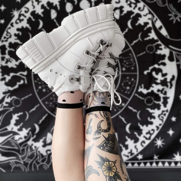 Photo shared by Karin on June 18, 2021 tagging @killstar, and @newrock. May be an image of one or more people, tattoo and footwear.