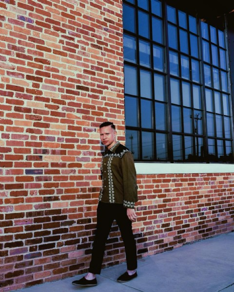 Photo by Enmanuel Peralta in Greenville, South Carolina. May be an image of 1 person, standing and brick wall.