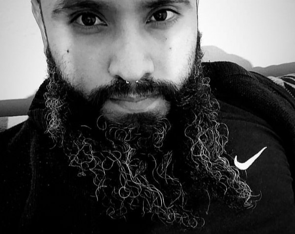 Photo by Carlos Sick  on June 18, 2021. May be a black-and-white image of one or more people and beard.