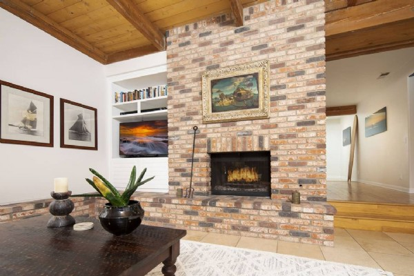 Photo by Brian Connolly on June 20, 2021. May be an image of hearth, brick wall and living room.