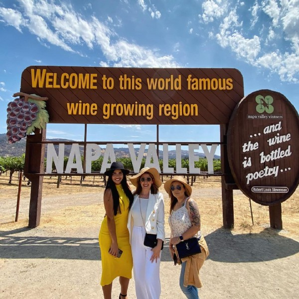 Photo shared by Roxanna Bernal on July 31, 2021 tagging @missbernal0410, and @camilaquirogac. May be an image of 3 people, people standing, outdoors and text that says 'WELCOME to this world famous wine growing region valley vintners and the wine is poetry... bottled Robert Louis Stevenson NAPAVALLEY'.