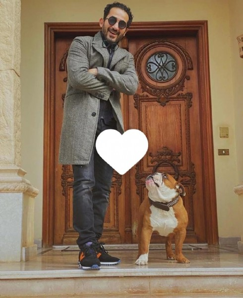 Photo shared by EGYPT | CELEBRITY ✪ on July 31, 2021 tagging @ronybrands, @osamaallamphotography, and @mariamwareth. May be an image of 1 person, standing and dog.