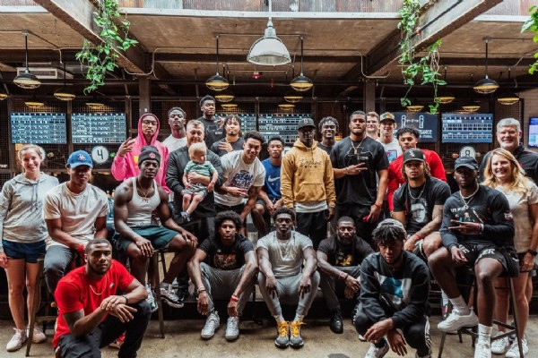 Photo shared by Ohio State Football on June 23, 2021 tagging @lathanransom, @j_proctor3, @theryanwatts_, @andrewmo0re, @cam.kittle, @cmart10k, @luh.cam, @_denzel.burke_, @run__dmc3, @lilmild, @k_dub.327, @lejond, @asvp_rocket_, @presidentlloyd, @7banks_, and @hooker_marcus23. May be an image of 21 people and people standing.