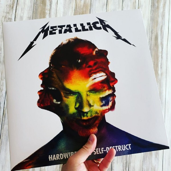 Photo shared by David Hopkins on June 11, 2021 tagging @instavinyl, and @metallica. May be an image of 2 people and text.