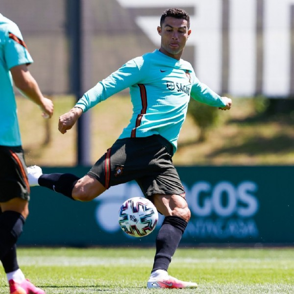 Photo shared by Cristiano Ronaldo on May 28, 2021 tagging @portugal. May be an image of 1 person, playing a sport and grass.