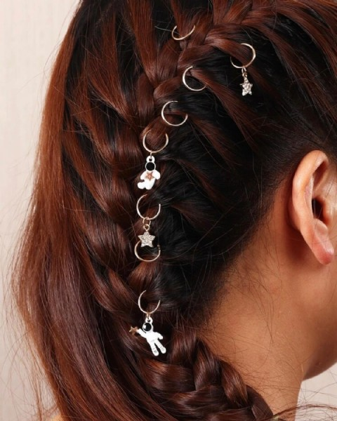 Photo by منصتنا لأجلنا Manasatna for us on August 02, 2021. May be an image of one or more people, braids and jewelry.