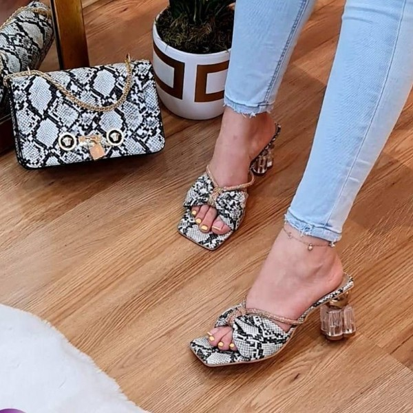 Photo by larsa_shoes_bags on August 02, 2021. May be an image of high-heeled shoes and sandals.
