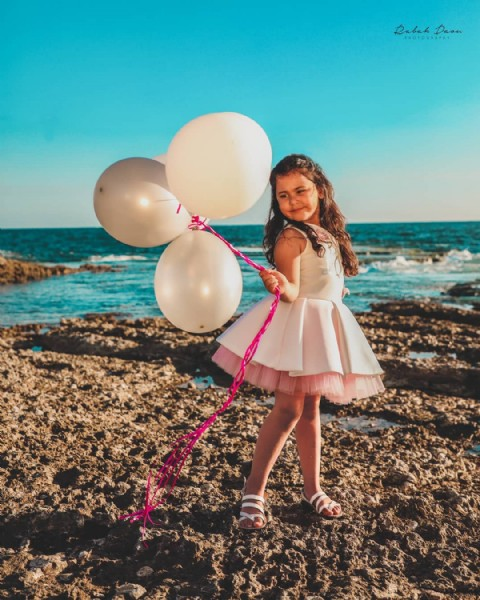 Photo shared by Rabah Daou on June 10, 2021 tagging @angels_tutu, and @lea.abed.elhak. May be an image of 1 person, child, standing, balloon and outdoors.