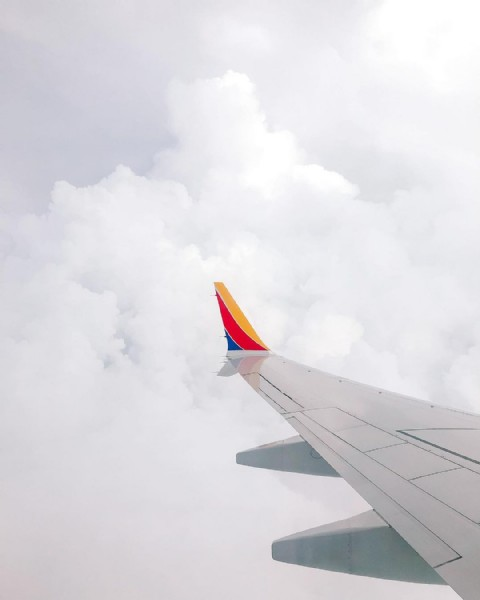 Photo by Brand & Wedding Photographer in Dallas Love Field with @southwestair. May be an image of airplane and cloud.